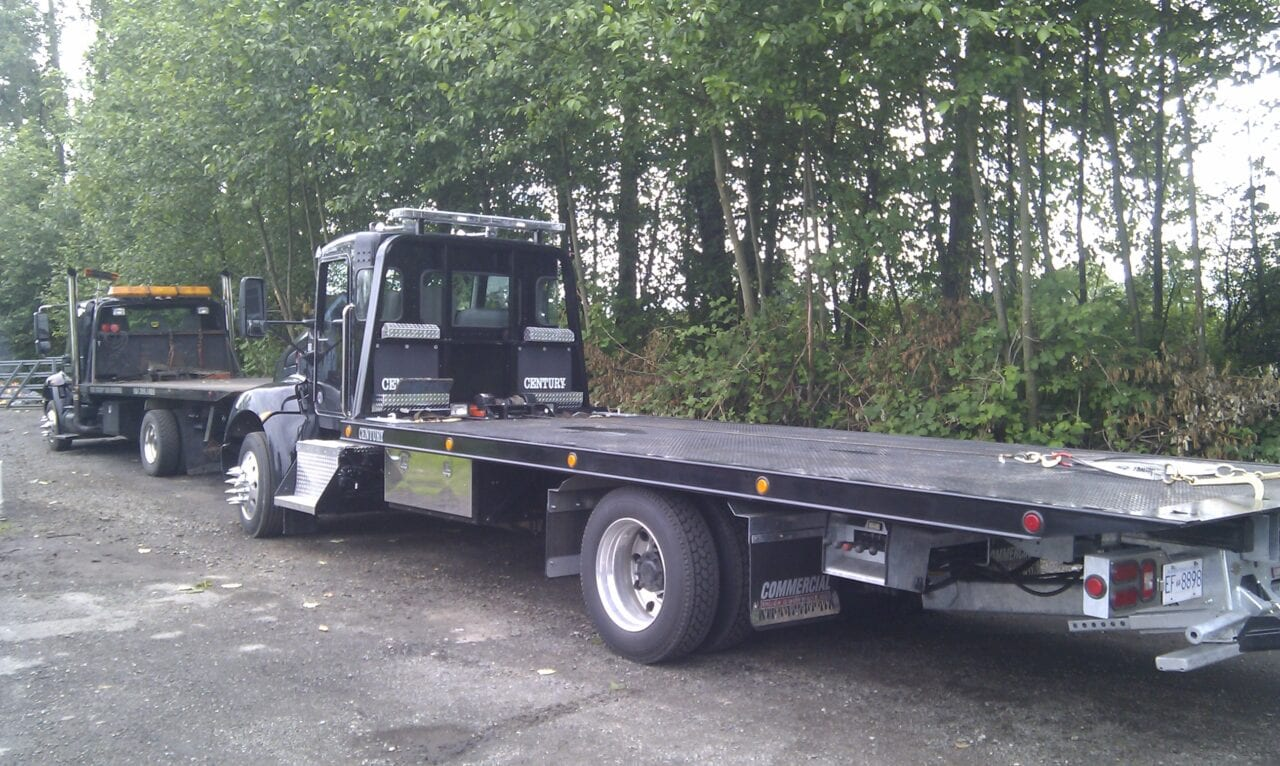 One of our flatbed tow trucks