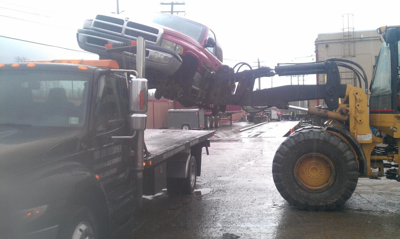 Placing a pickup on a flatbed truck