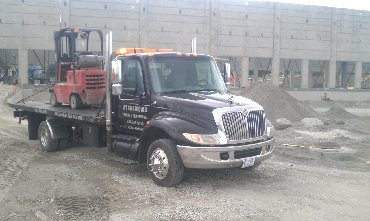 We Do Recover towing a forklift